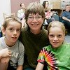 "The Leahy family from left, Jack ,9, Deb, and Hannah, 10, of Swampscott enjoy the ""Pirates Night"" family night program at the Swampscott Library Tuesday. The event included live pirate performers along with a temporary tattoo to wear through the evening. Photo by Deborah Parker/July 7, 2009."
