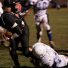 Salem: Salem's Melikke VanAlstyne is brought down by Peabody's Nick Hiou during Saturday night's game at Bertram Field. Photo by Deborah Parker/Salem News Saturday, November 1, 2008.