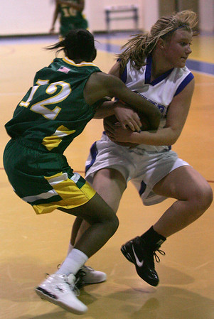 Danvers' Allison Tivnan and Lynn Classical's Tashanna Brown fight for control of the ball during last night's Division 2 North girls basketball firt round playoff game held at Danvers High School. Photo by Deborah Parker/February 24, 2010