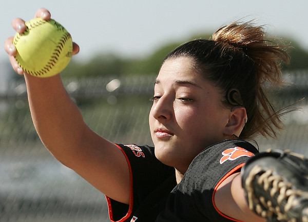 Beverly pitcher Sarah Pezzulo, a sophomore, is having a great season. She is also deaf and wears a cochlear implant, although few, if any, of her opponents know this. Photo by Deborah Parker/May 21, 2009