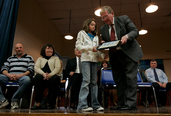 Peabody: Thursday afternoon the Center School held a presentation to celebrate the newly installed windows at the school. Special guests included Mayor Michael Bonfanti and Superintendent C. Milton Burnett. Here, Natalie Phelan presents a drawing she made of the new windows to the Superintendent, C. Milton Burnett. Photo by Deborah Parker/Salem News Thursday, March 19, 2009.