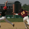 Masco's Gabe Dunn is tagged by Boston College High's Ryan Tufts while trying to reach third base during yesterday's game held at Masco. Photo by Deborah Parker/May 25, 2010