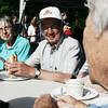 Judy McLaughlin and Ernie Lang of Beverly chat with Carole Pizzello, far right, of Florida during the Veterans Cookout at Lynch Park Friday afternoon, as part of Beverly Homecoming. Photo by Deborah Parker/August 7, 2009