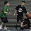 Liam Finnegan, 9 and Kyle Morfis, 9, both of peabody, perform a defensive drill as part of a free youth basketball clinic in conjunction with the Tanner City Holiday Classic basketball tournament at Peabody High School Tuesday morning. photo by deborah parker/december 28, 2010