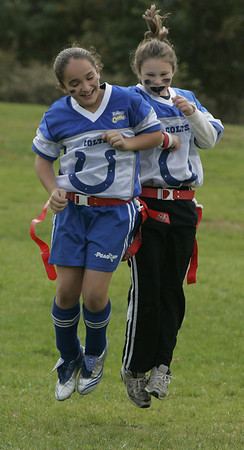 Peabody: Kayla Santos and Robin Hendry celebrate after scoring a touchdown during their flag football game at Emerson Park Saturday. Photo by Deborah Parker/Salem News Saturday, October 25, 2008