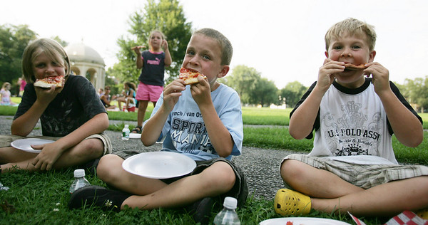 Cousins, from left, Tristin Cooper-Berthe, 8, from Washington D.C., Ben Cregrier, 7, of Salem and Aidan Cooper-Berthe, 6, from D.C., take a bite out of their pizza during the Heritage Days Pizza Competition held at the Salem Common Monday evening. Photo by Deborah Parker/August 9, 2010