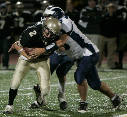 Peabody: Bishop Fenwick's Chris Renzulli is taken down by Swampscott's (there was no roster) during yesterday's game at Fenwick. Photo by Deborah Parker/Salem News Friday, October 17, 2008.