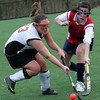 Beverly's Allie Donnelly and Brookline's Aliza Miller fight for control of the ball during the Division 1 North first round tournament field hockey game held at Salem State College Thursday afternoon. Photo by Deborah Parker/November 5, 2009