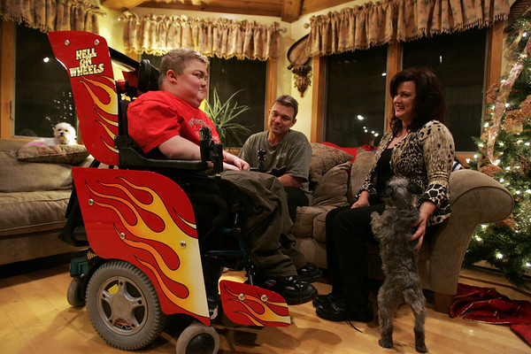 Recently a New Hampshire racing company, Dan Page Racing, worked to vamp up the wheelchair of 15-year-old Max Gaudenzi. His wheelchair now has speakers for his iPod, fire decals and even a skull decal on the steering control. Max is seen here with his parents Paul and Natalie. Photo by deborah parker/novemer 29, 2010