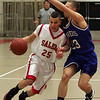 Salem's Derek McIntyre is defended in front of the hoop by Danvers' Nick Strangie durng last night's game held at Salem High School. Photo by Deborah Parker/January 25, 2009