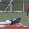 St. Johns' Tyler Connaughton makes it back to first safely before being tagged by Central Catholic's D.J. Swarbrick during yesterday's game held in Danvers. Photo by Deborah Parker/May 19, 2010