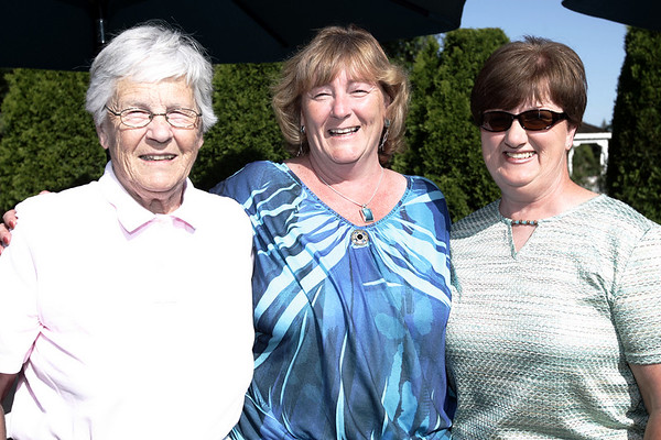 From left, Ella Young of Ipswich, Vicki Chouinard of Dracut and Cyndy Morong of Wenham pose for a picture before surprising Bert Russell with a honorary diploma from Beverly High School, 50 years after he left school early to serve in the Korean War.