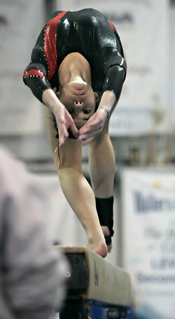 Middleton: Salem High School gymnast Amy Burke performs on the balance beem during the team's meet held at Yellow Jackets in Middleton Saturday evening. Photo by Deborah Parker/Salem News Saturday, January 17, 2009.