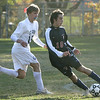 Danvers: Central Catholic's Daniel Caruso keeps the ball away from St. John's Zachary Hathaway during Saturday's game at St. John's Prep. Photo by Deborah Parker/Salem News Saturday, October 18, 2008