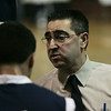 Beverly : New Peabody High School boy's basketball coach, Dominic Coleman, speaks to the team in between quarters during their game at Bevery Friday evening. Photo by Deborah Parker/Salem News Friday, December 12, 2008