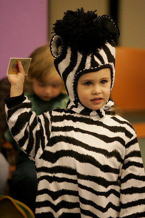 Peabody: Dressed as a Zebra, Brooklyn Odoardi, 3, of Peabody, raises her right hand as she is sworn in as a junior police officer during a Halloween Party held at the Peabody Institute Library Thursday. Officer Eon of the Peabody Police along gave a short presentation on Halloween safety then passed out sticker police badges.  Photo by Deborah Parker/ Salem News Thursday, October 30, 2008.