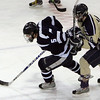 Peabody's Eric Muise tries to maintain control of the puck while being defended by Winthrop's Joe Casey during last night's Division 1 North Semifinal game held at Chelmsford Forum Arena. Photo by Deborah Parker/March 1, 2010<br /> ce, Peabody's Eric Muise tries to maintain control of the puck while being defended by Winthrop's Joe Casey during last night's Division 1 North Semifinal game held at Chelmsford Forum Arena. Photo by Deborah Parker/March 1, 2010<br /> ce