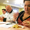 From left Ilya Tsypkin of Cassis Bakery, Ed Charest of Endicott College, and Angela Dominick of Dom's Trattoria judge a piece of pie yesterday at Essex Park's Annual Fall Pie Baking Contest. Photo by Deborah Parker/November 17, 2009