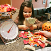 Salem dentists Kevin Kelaher and Quynh Bui, will make a $20  charity donation to the Boys and Girls Club give children a $5 gift card to McDonald's for every pound of Halloween candy they bring into the office on November 2, and 3. Pictured is Abbey Gonzalez, 4, of Salem.