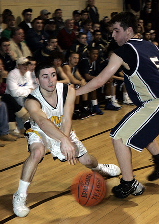 Beverly : Bishop Fenwick's Nolan DiPanfilo passes the ball around (*no roster) St. Mary's #5 Bakopolus during Friday night's game at Bishop Fenwick. Photo by Deborah Parker/Salem News Friday, January 09, 2009