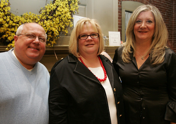 From left, Peter Borflinger of Lynnfield, Denise Dwelley of Lynn and Ivy Borflinger of Lynnfield, attend a wine tasting and silent auction held at the Lyceum Restaurant to benefit Northeast Arc. Photo by Deborah Parker/April 9, 2010