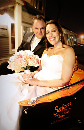 "Salem: Newlyweds and Salem residents Guy Leger and LIsa Fishbone held a ""recession"" wedding for under $10,000 Friday evening. The ceremony was held at Old Town Hall with the reception at Finz Restaurant. They opted to have Salem Pedicabs for their transportation instead of the traditional limo. Photo by Deborah Parker/May 01, 2009."