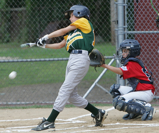 Manchester Essex's Alex Beckman bats against Boxford's Chase Zernich during yesterday's Williamsport tournament game held at Moulton Field in Danvers. Photo by Deborah Parker/June 29, 2010