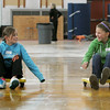 Ally Kramer, 10, and Amanda Rosenberger, 10, both of Beverly, race each other down the side of the field house while at Beverly High School Tuesday morning. The Beverly High School class of 2010 hosted a Elementary Fun Day which included crafts, games, and a visit by the Beverly Panther. Photo by Deborah Parker/Novemeber 3, 2009