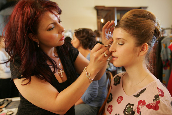 Andrea Ducharme of Rouge Cosmetics applies makeup to Talia Lipkind of Marblehead before the start of the Lifebridge Fashion Show held at the Nathaniel Silsbee House Thursday evening. Photo by Deborah Parker/April 15, 2010