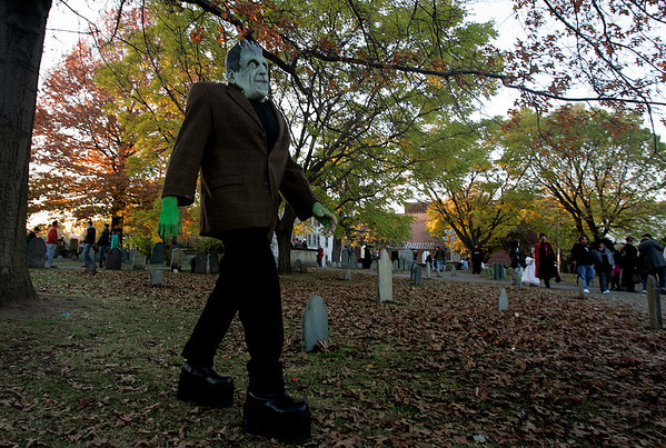 Salem: Dressed as Frankenstein, Rick Hamlin visiting from Texas, explored a graveyard in downtown Salem Halloween night. This is the third Halloween Rick and his family have made the trip north to Salem. Photo by Deborah Parker/Salem News, Friday, October 31, 2008.