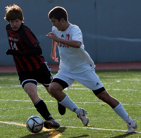 Lowell: Masco's Andrew Panella fights for control of the ball against Mt. Greylock's Stephan Danyluk during Saturday's Division 2 State Championship soccer game in Lowell. Masco was defeated 3-2. Photo by Deborah Parker/Salem News Saturday, November 22, 2008.