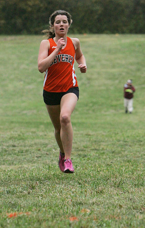 Beverly's Millie Chapman crosses the finish line to win yesterday's meet against Salem at J.C. Phillips Nature Preserve in Beverly . Photo by Deborah Parker/October 27, 2009