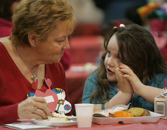 Elise Anderson of Lynn chats with her grand daughter Cynthia Anderson, 7, over breakfast during a special Valentine's Day brunch held at McCarthy Elementary School in Peabody Friday morning. PHoto by Deborah Parker/February 12, 2010