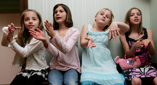 "From left, Alexa Grant, 8, Christina Koenig, 7, Abigail Bettencourt, 8, and Alexa Argenio, 7, all of Beverly, clap their hand to music during ""Ciao Centerville, Chow Pizza"" a fundraiser for the Centerville PTO held at the Vittori Rocci Post Friday evening. Photo by Deborah Parker/April 9, 2010"