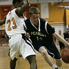 Beverly : Peabody's A.J. Grube pushes his way past Beverly's Mike Clayton during their game at Bevery Friday evening. Photo by Deborah Parker/Salem News Friday, December 12, 2008