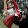 Salem: Krysta McCallion, 4, of Lowell gives a big smile to her mom, Kelly Ballum while yelling to go higher as they played on the swing sets at Salem Common Sunday afternoon. The two took advantage of the unusually warm weather to visit a bench in the Common that was dedicated to Krysta's grandmother, Dorothy Cann. Photo by Deborah Parker/Salem News Sunday, December 28, 2008.