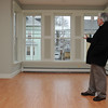 Peabody:<br /> Don Preston  shows off the livingroom of one of the two new units built by Habitat for Humanity at 5 Park Street.<br /> Photo by Ken Yuszkus/Salem News, Monday, April 4, 2011.