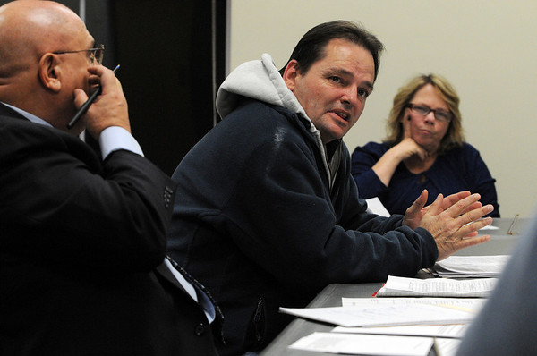 Salem:<br /> From left, Chris Ducas, attorney, listens to his client, Paul Dacey, speak, and Beth Rennard, city solicitor, listens at the hearing on Hilltop Manor.<br /> Photo by Ken Yuszkus/Salem News, Monday, February 13, 2012.