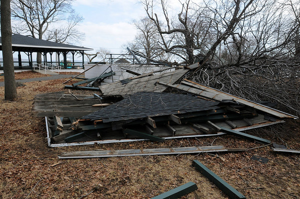 Salem:<br /> Last nights wind storm knocked a tree onto a roofed pinic structure which leveled the building at Salem Willows. The structure on the left is similar to what the building looked like before it was destroyed.<br /> Photo by Ken Yuszkus/Salem News, Friday, February 26, 2010.