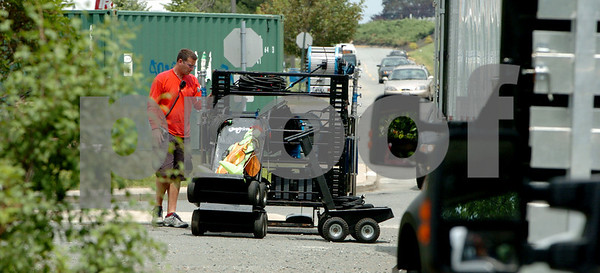 Peabody:<br /> Removing gear from one of the tractor trailers for filming a movie scene at the Lahey Clinic for a movie that involves Ben Afleck.<br /> Photo by Ken Yuszkus/Salem News,  Tuesday, June 2, 2009.