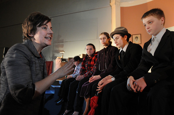 "Salem:<br /> Katie Oberlander gives instructions to the actors at the start of rehearsal at the Salem Y. She is directing ""Out of Circulation,"" a play that she wrote. <br /> Photo by Ken Yuszkus/Salem News, Tuesday, March 29, 2011."