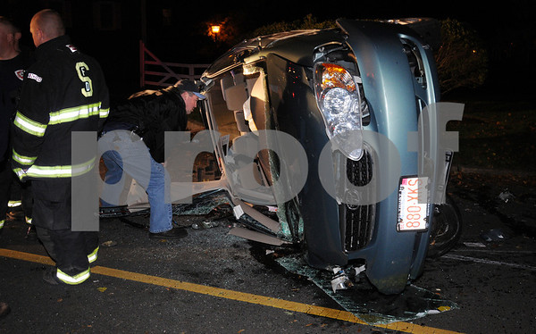 Salem:<br /> A woman and her dog were injured in a rollover accident on Memorial Drive. please see story on page 13.<br /> Photo by Ken Yuszkus/Salem News, Monday October 19, 2009.