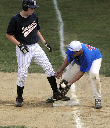 Salem:<br /> Swampscott's #15 gets back on first base safely in a pick off try by Danvers' first baseman Corey Crossley during the Gallant Memorial youth baseball tournament final at Forest River Park, Salem between Danvers and Swampscott.<br /> Photo by Ken Yuszkus/Salem News, Tuesday August 17, 2010.
