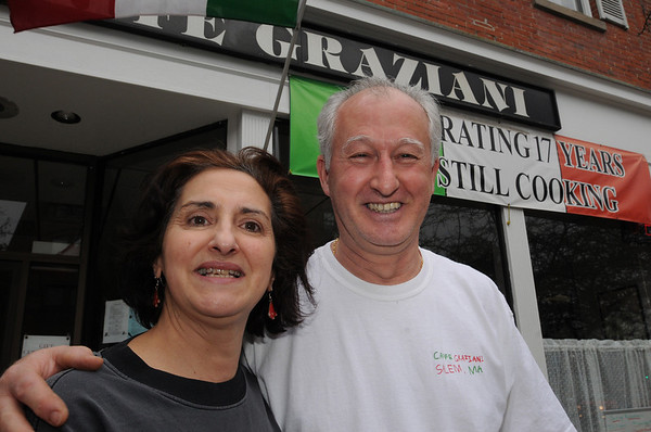 Salem:<br /> Caffe Graziani owners Paula Gravallese and Giovanni Graziani stand in front of their business. They are concerned about the impact of the rising cost of health insurance on small business owners.<br /> Photo by Ken Yuszkus/Salem News, Thursday, March 11, 2010.