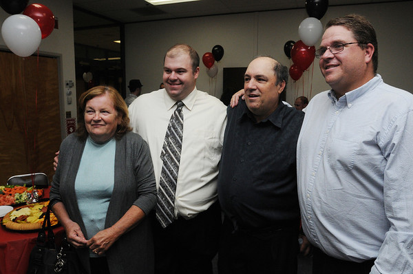 Beverly:<br /> From left, Jean DePlacido, sports reporter for the Salem News, Matt Roy, reporter from the Lynn Item, Mike Grenier and Phil Stacey, from the Salem News,  pose for a photo during Mike's retirement reception at the Salem News on Thursday evening.<br /> Photo by Ken Yuszkus/Salem News, Thursday, September 8, 2011.