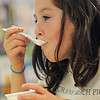 Ipswich:<br /> Angela Parro, 2nd grader from Maureen O'Connell's class at the Paul F. Doyon Memorial School, tastes her cup of Cornelius Crunch which was specially created for the day by White Farms ice cream. The ice cream was part of the celebration of the 100th anniversary of the Crane Beach Picnic, which is Monday. The Paul F. Doyon Memorial School and Winthrop Elementary School tasted the special ice cream and the students played 1900's-era games on Friday.<br /> Photo by Ken Yuszkus/Salem News, Friday, June 17, 2011.