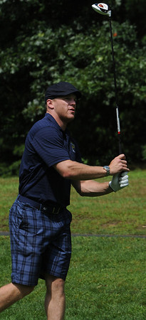 "Danvers:<br /> Boston Bruins player Shawn Thornton tees off at the 15th tee at Ferncroft Country Club during his annual ""Putts and Punches for Parkinson's"" charity golf fundraiser.<br /> Photo by Ken Yuszkus/Salem News, Monday, August 8, 2011."