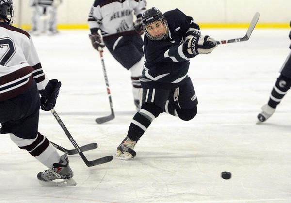 Hamilton:<br /> Pingree's Nate Sorter shoots for the net at the Pingree School boys hockey season opener vs. Belmont Hill.<br /> Photo by Ken Yuszkus/Salem News, Wednesday, Decmber 2, 2009.