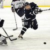 Hamilton:<br /> Pingree's Nate Sorter shoots for the net at the Pingree School boys hockey season opener vs. Belmont Hill.<br /> Photo by Ken Yuszkus/Salem News, Wednesday, Decmber 2, 2009.