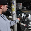 "Salem:<br /> Matthew Bernier places quarters into the new meter on Washington Street in Salem. Salem has 50 new ""smart"" parking meters downtown that accept credit cards. <br /> Photo by Ken Yuszkus/Salem News, Tuesday,  March 6, 2012."